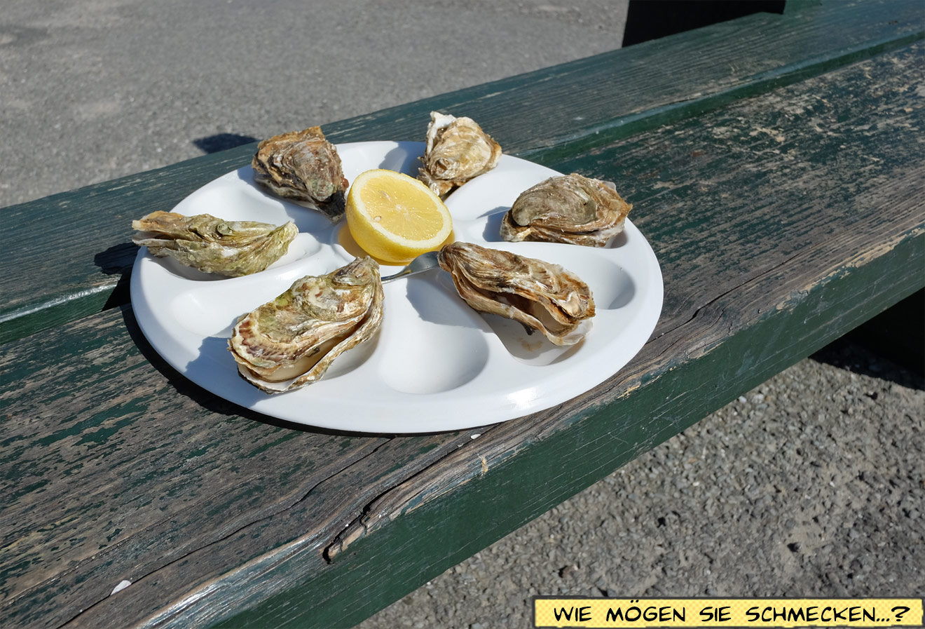 Halbes Dutzend Austern mit Zitrone